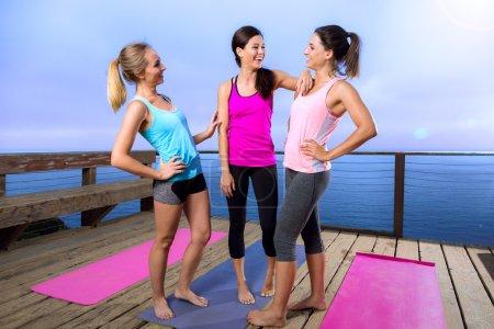 Friends spiritual bond yoga classmates laugh casual conversation friendly before class