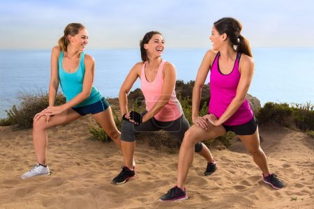Casual conversation athletes stretching in exercise class outdoors before jog and hike on trail path