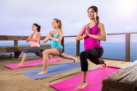 Yoga class at beach beautiful location beach ocean retreat healthy lifestyle peaceful