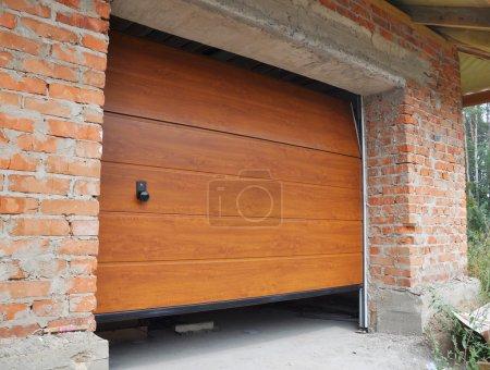 Close up on Install New House Garage Door.  Garage...