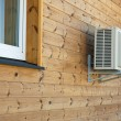 Air conditioner condenser on the wooden wall of bo...