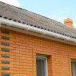 Asbestos roof with plastic rain gutter...