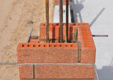 Closeup. Lay bricks and blocks correctly.