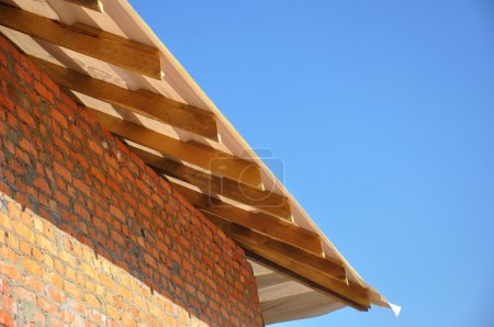 Layout and Installation of Roof Fafters and Eaves on a New Comme