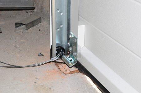 Close up on Installing Garage Door. Garage Door Post Rail and Spring Installation