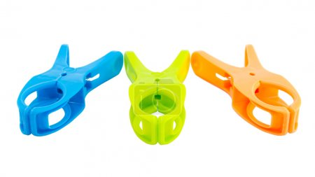 Three plastic spring clamps isolated over white background