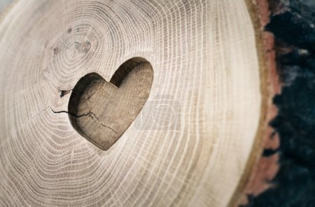 Wood carving, symbol of love, the heart. Background for your des