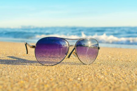 Photo for Sunglasses on the beach - Royalty Free Image