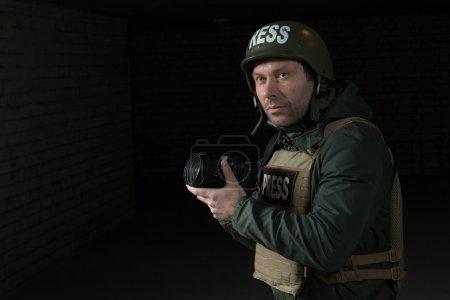 Photographer in helmet and flak jacket