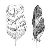 Artistically drawn stylized vector set of two feathers on a white background Illustration is created from a personal sketch by trace Series of doodle feathers