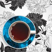 cup of coffee on floral ornament