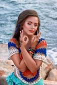 ethnic fashion photo, beautiful girl, bright clothes, summer ocean beach