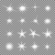 Vector set of glowing light bursts with sparkles o...