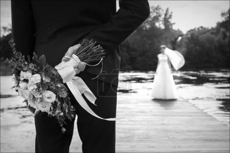 Wedding. Bride and groom. Bouquet for the bride . Black and white