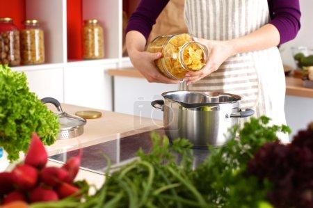 Cooks hands preparing vegetable salad - closeup shot