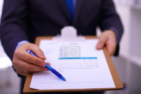 Businessman holding a blank white board