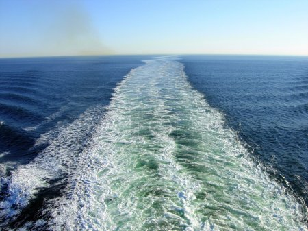 Waves and exhaust gases from a ship