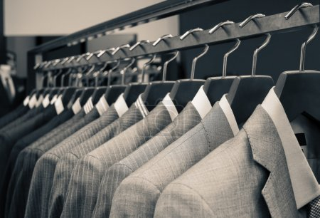 Photo for Men suits hanging in a clothing store. - Royalty Free Image