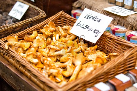 Fresh chanterelles exposed in baskets in Borough M...