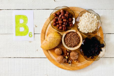 Foods containing vitamin B 6: hazelnuts, potatoes,...