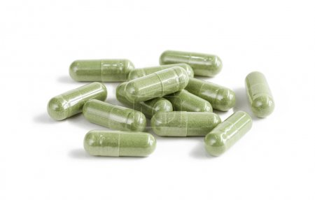 Photo for Capsules of green herbal supplement product isolated on white background - Royalty Free Image