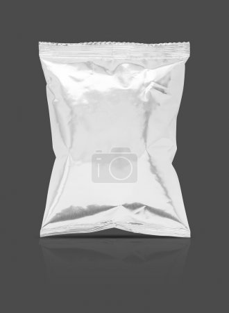 Blank packaging foil snack pouch isolated on gray background