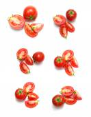 Rajčaty a plátky rajčat na bílém pozadí