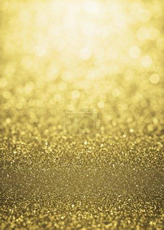 Foto de Desenfocada fondo de luces de destellos oro brillo. Fondo de bokeh brillo resaltada - Imagen libre de derechos