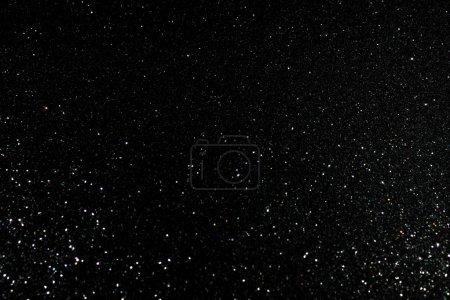 Photo pour Mode scintillante fond noir avec texture granuleuse scintillante - image libre de droit