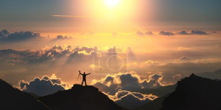 Photo for A man standing on the top of the mountain above the clouds. - Royalty Free Image