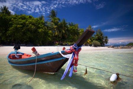 White sand, crystalline sea, bright blue sky and p...