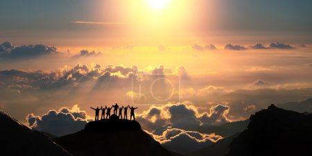Photo for A group of people stands on a hill over the beautiful cloudscape. - Royalty Free Image