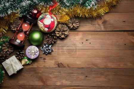 Photo for Christmas decorations on dark wooden background. Top view - Royalty Free Image