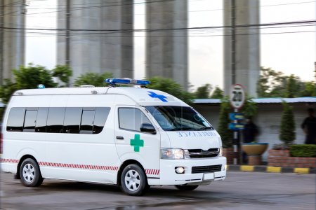 Photo for Ambulance on emergency call in motion blur - Royalty Free Image