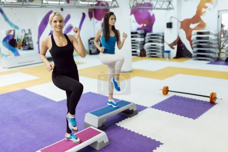 Women exercising aerobics