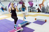 Women exercising aerobics