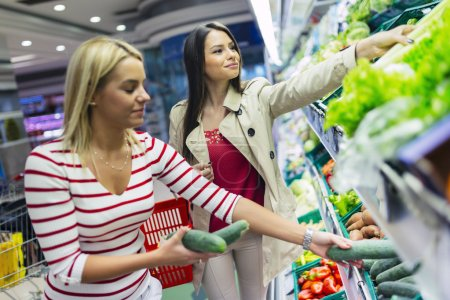 Photo for Beautiful women shopping  fruits in supermarket - Royalty Free Image