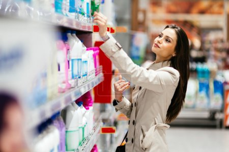 Photo for Beautiful  brunette woman shopping in supermarket - Royalty Free Image