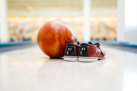 pair of shoes and a bowling ball