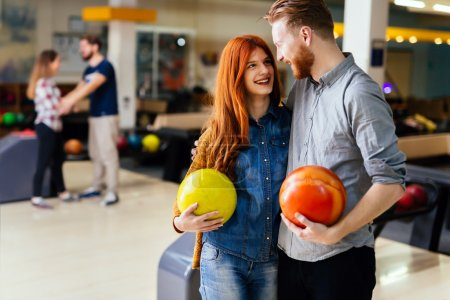 Beautiful couple dating and bowling