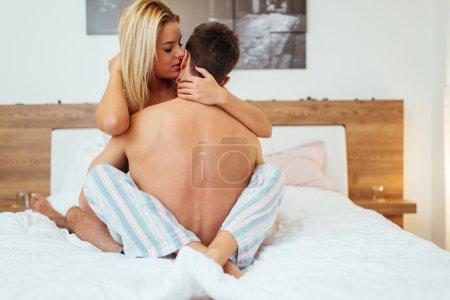 Beautiful couple in bedroom