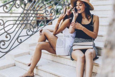 Women talking with boyfriends on phone