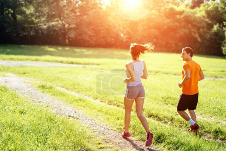 Beautiful couple jogging in nature