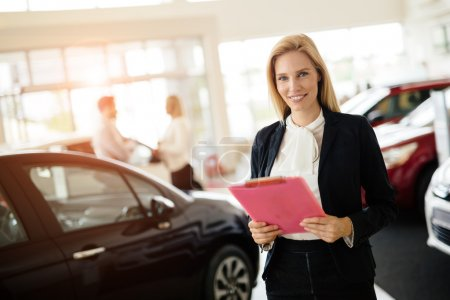 Photo for Professional salesperson working in car dealership - Royalty Free Image