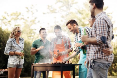 Friends camping and having a barbecue