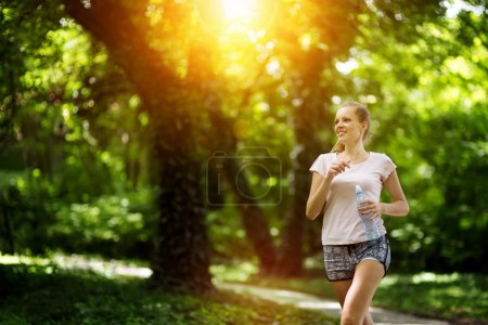 Beautiful female jogger in nature