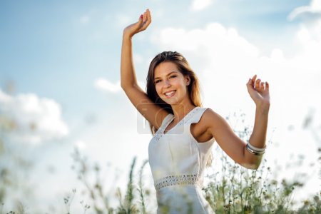 Photo for Beautiful woman without pollen allergy in chamomile field - Royalty Free Image