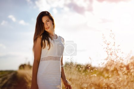 Photo for Dreamy beautiful woman posing in field - Royalty Free Image