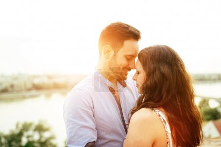 Photo for Couple in love hugging outdoors and sharing true emotions - Royalty Free Image