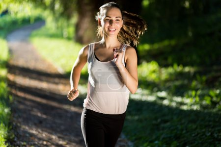 Photo for Beautiful woman running  in nature - Royalty Free Image